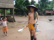 A Nam Ou fisher returning from retrieving his catch early in the morning using a fixed gillnet. Photo taken in May 2010. Similar gears are in use around the Nam Ton / Mekong confluence point