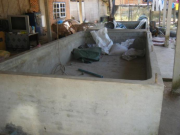 A hatchery tank at the km52 fish breeding center between the NTPA and Vientiane. This is an approximate example of what could be built in Sangthong and Hin Herb Districts. Photo taken in December 2011